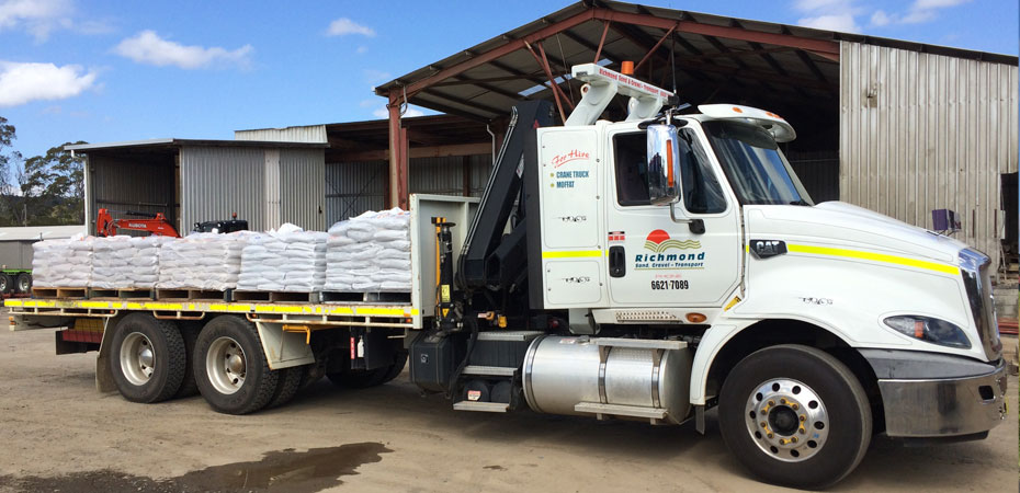 Richmond-Sand-Gravel-Landscaping-crane-truck-pallets